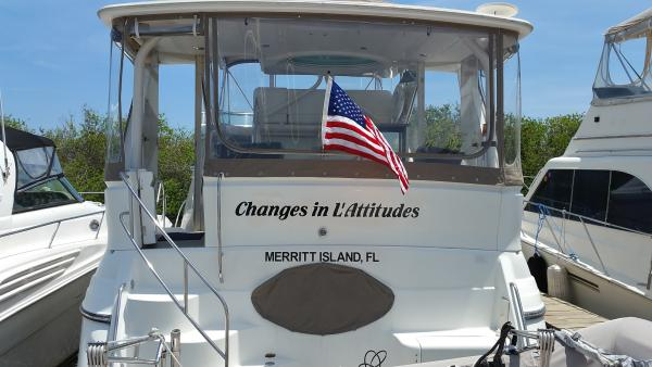 The new name is on and the ensign is flying.